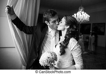 Gorgeous wedding couple kissing