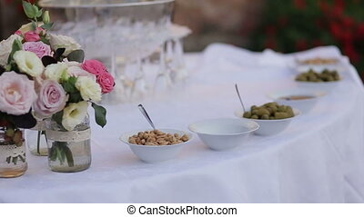 Gorgeous wedding  table setting for fine dining outdoors decorated with flowers
