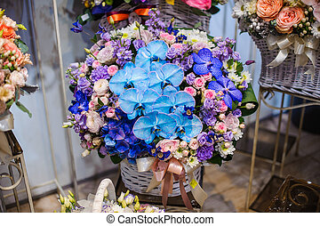 Gorgeous wicker basket with beautiful and colorful flower composition