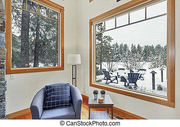 Gorgeous window view of snowy patio