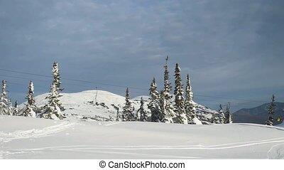 Gorgeous winter mountains panorama with ski slopes and ski...