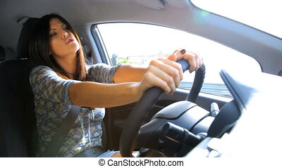 Gorgeous woman driving car singing - Beautiful happy woman...