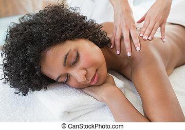 Gorgeous woman enjoying a shoulder massage