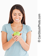 Gorgeous woman holding a green apple
