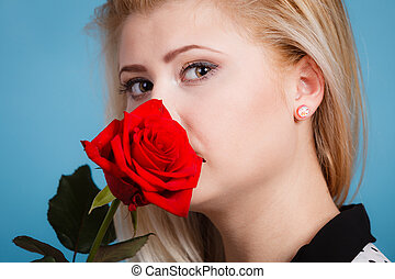 Gorgeous woman holding red rose flower.