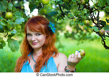 Gorgeous woman in an orchard