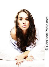gorgeous woman in bed on white background