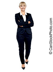 Gorgeous woman in business suit walking towards you