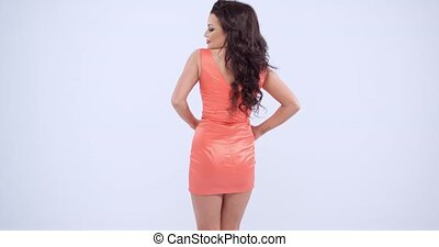 Gorgeous Woman in Orange Peach Dress