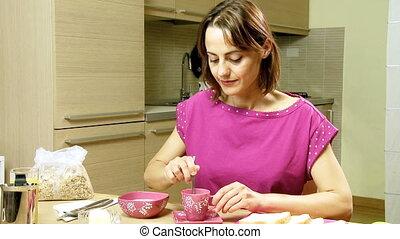 gorgeous woman in pajamas breakfast