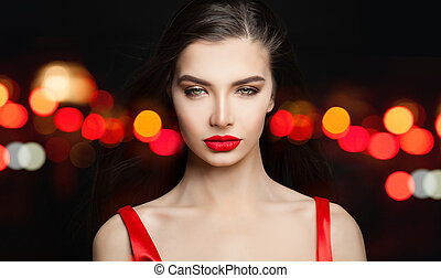 Gorgeous woman on black carnival background