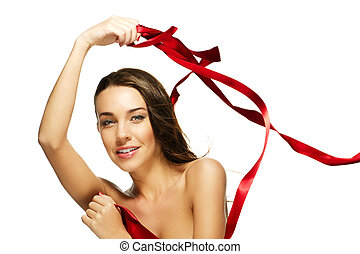 gorgeous woman playing with a red ribbon on white background