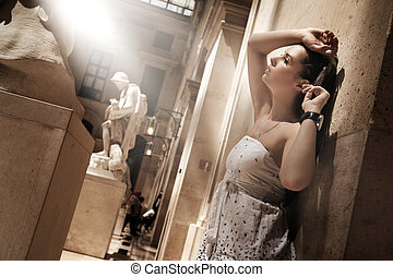 Gorgeous woman posing in a glamourous interior