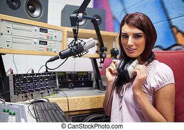 Gorgeous woman posing in a studio