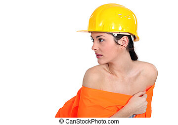 Gorgeous woman posing in construction worker dress