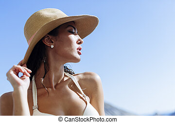 Gorgeous woman posing in hat outdoors