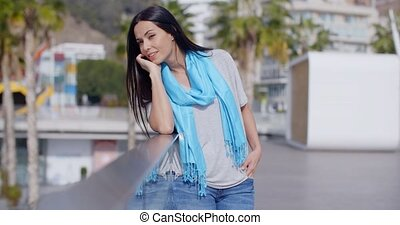 Gorgeous woman putting hand through hair - Gorgeous young...