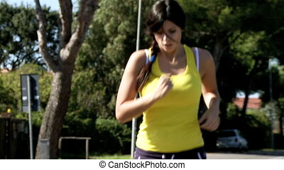 beautiful female model jogging medium shot slow motion