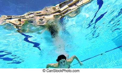 Gorgeous woman swimming underwater