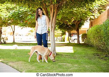Gorgeous woman walking her dog