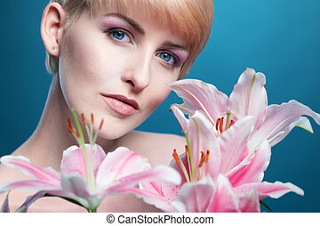 Gorgeous woman with a bunch of pink lilies
