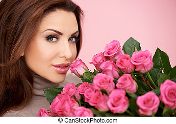 Gorgeous woman with a bunch of roses