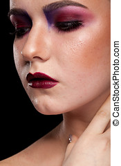 Gorgeous woman with artistic professional make up