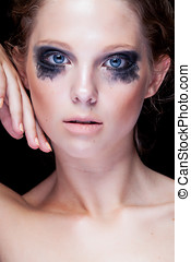 Gorgeous woman with black crying make up