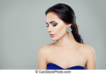 Gorgeous woman with earrings, portrait