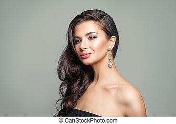 Gorgeous Woman with Jewelry Diamond Earrings. Beautiful Girl Fashion Portrait