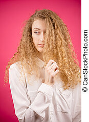 gorgeous woman with shiny fair wealth of hair