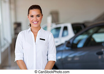 woman working at vehicle showroom