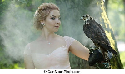 Gorgeous Women Outdoors. Fashionable Girl with Bird of prey...