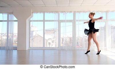 Gorgeous young ballerina practising ballet moves - Gorgeous...
