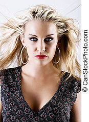 Gorgeous young blond female with flying hair