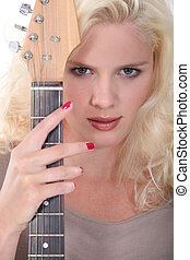 gorgeous young blonde with guitar