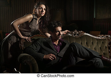 Gorgeous young couple in a stylish interior