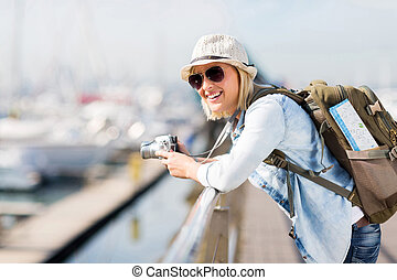 young female traveller at the harbour