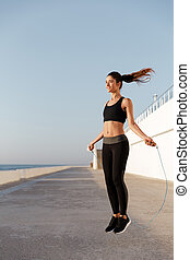 Gorgeous young happy sports woman make sport exercises