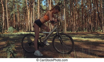 gorgeous young lady with a Bicycle