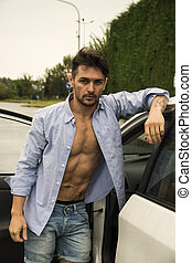 Gorgeous Young Man with Shirt Open on Naked Muscular Torso Getting Out his Car