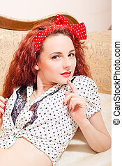 Gorgeous young pinup female with long red hair