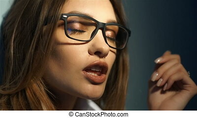 Gorgeous young seductive girl in glasses with beautiful make up