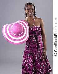 Gorgeous young South African woman in a bright dress