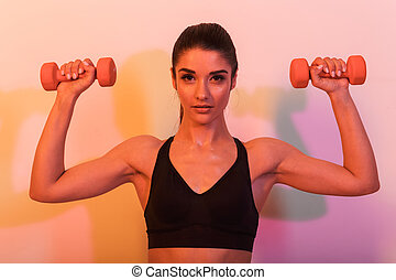 Gorgeous young sports woman make exercises