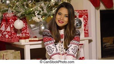 Gorgeous young woman enjoying Christmas