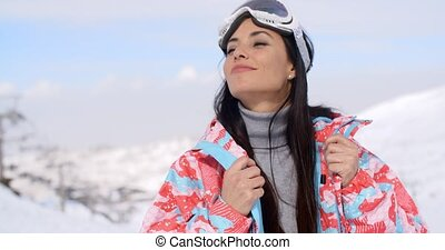 Gorgeous young woman enjoying the winter view as she...