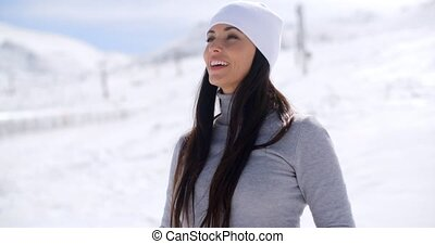Gorgeous young woman in a snowy landscape