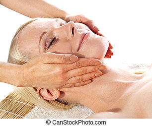 Gorgeous young woman relaxing in a spa salon