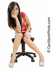 Gorgeous young woman sitting on a chair isolated over white background